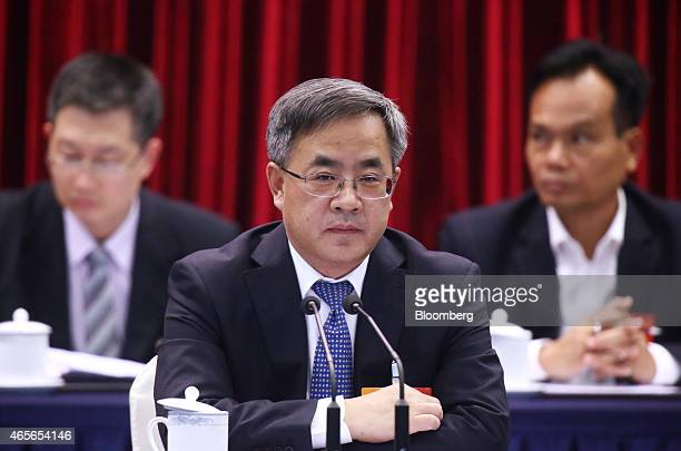 Hu Chunhua Chinese Communist Party secretary of Guangdong Province center attends a delegation meeting on the sidelines of the third session of the...