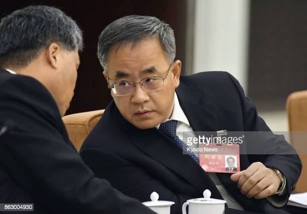 Hu Chunhua secretary of China's Communist Party in Guangdong Province attends a group meeting on the sidelines of the national party congress at the...