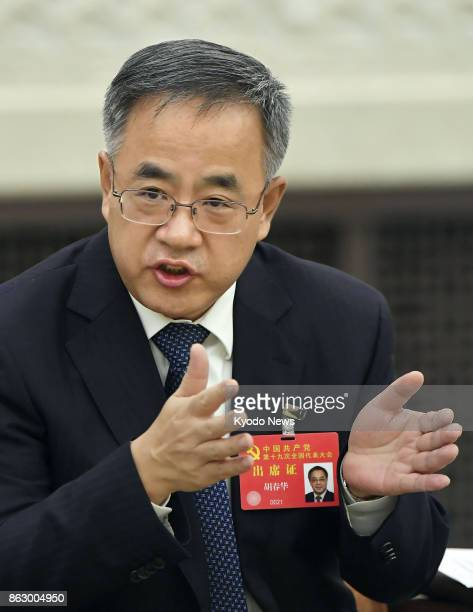 Hu Chunhua secretary of China's Communist Party in Guangdong Province speaks to reporters on the sidelines of the national party congress at the...