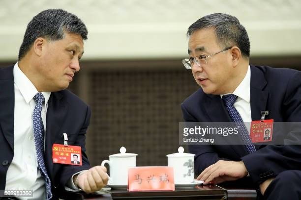 Hu Chunhua Secretary of the CPC Guangdong Provincial Committee with Governor of Guangdong province Ma Xingrui attends a meeting of the 19th Communist...
