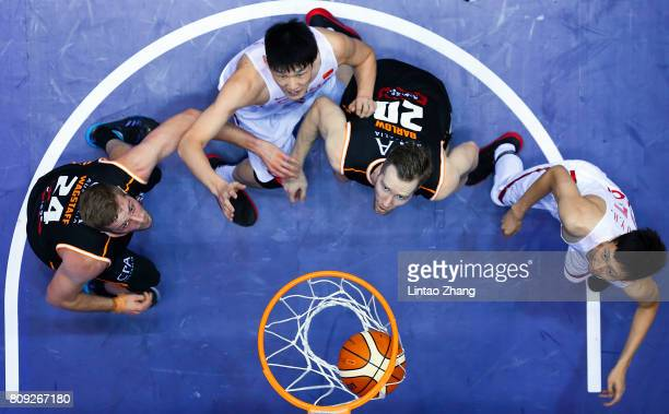 Hu Jinqiu of China drives to the basket against Jesse Wagstaff and David Barlow of Australia during the 2017 SinoAustralia Men's International...