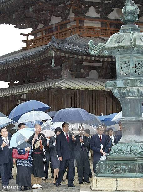 Hu Jintao China's president center arrives at the Horyuji temple in Ikaruga Town Nara Prefecture Japan on Saturday May 10 2008 Japan and China...