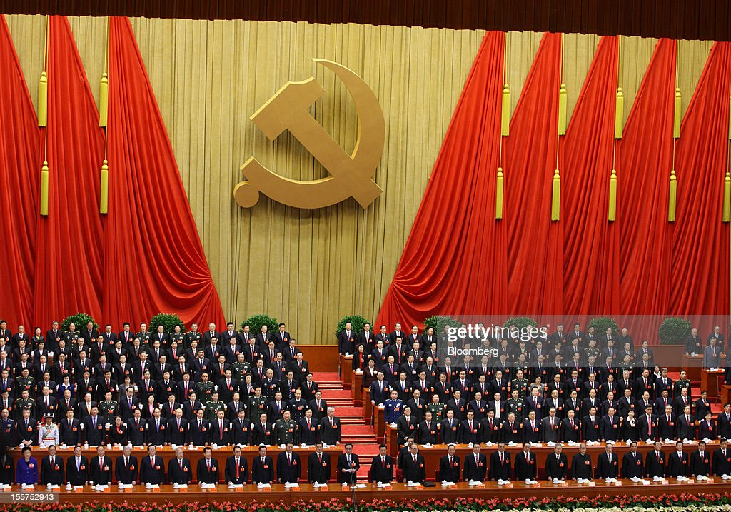 Hu Jintao, China's president, center in the front row, Jiang Zemin, former president, center right in the front row, and Xi Jinping, vice president, 12th from left in the front row, attend the opening of the 18th National Congress of the Communist Party of China at the Great Hall of the People in Beijing, China, on Thursday, Nov. 8, 2012. China's Communist Party kicked off a congress in Beijing to choose its fifth generation of leaders since taking power in 1949, a decision that will shape the nation's economic and financial policies for the next decade. Photographer: Tomohiro Ohsumi/Bloomberg via Getty Images