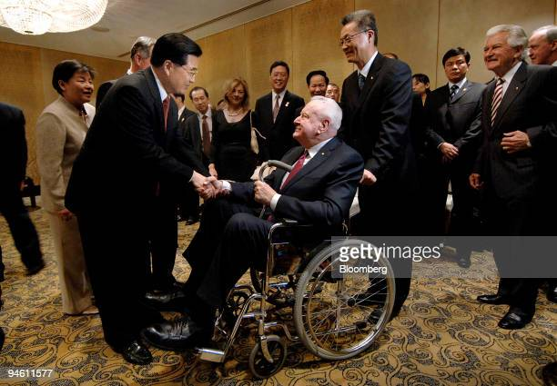 Hu Jintao China's president left greets 90 year old former Australian Prime Minister Gough Whitlam prior to a ministerial dinner on day four of the...