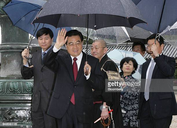 Hu Jintao China's president second from left waves as he leaves the Horyuji temple in Ikaruga Town Nara Prefecture Japan on Saturday May 10 2008...