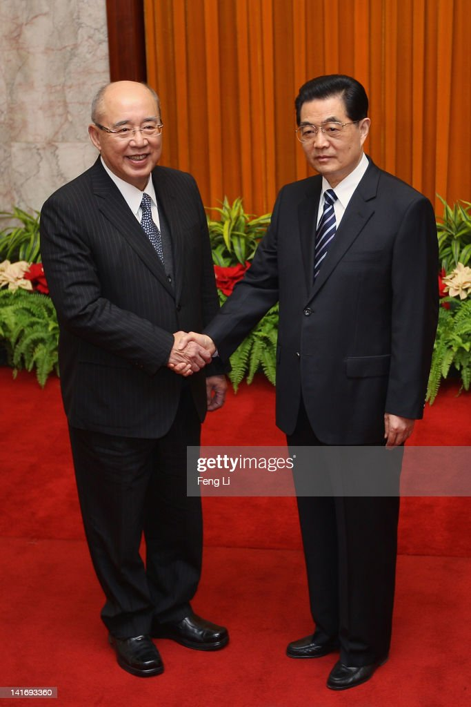 Hu Jintao General Secretary of the Communist Party of China Central Committee shakes hands with Kuomintang Party honorary chairman Wu Pohhsiung...