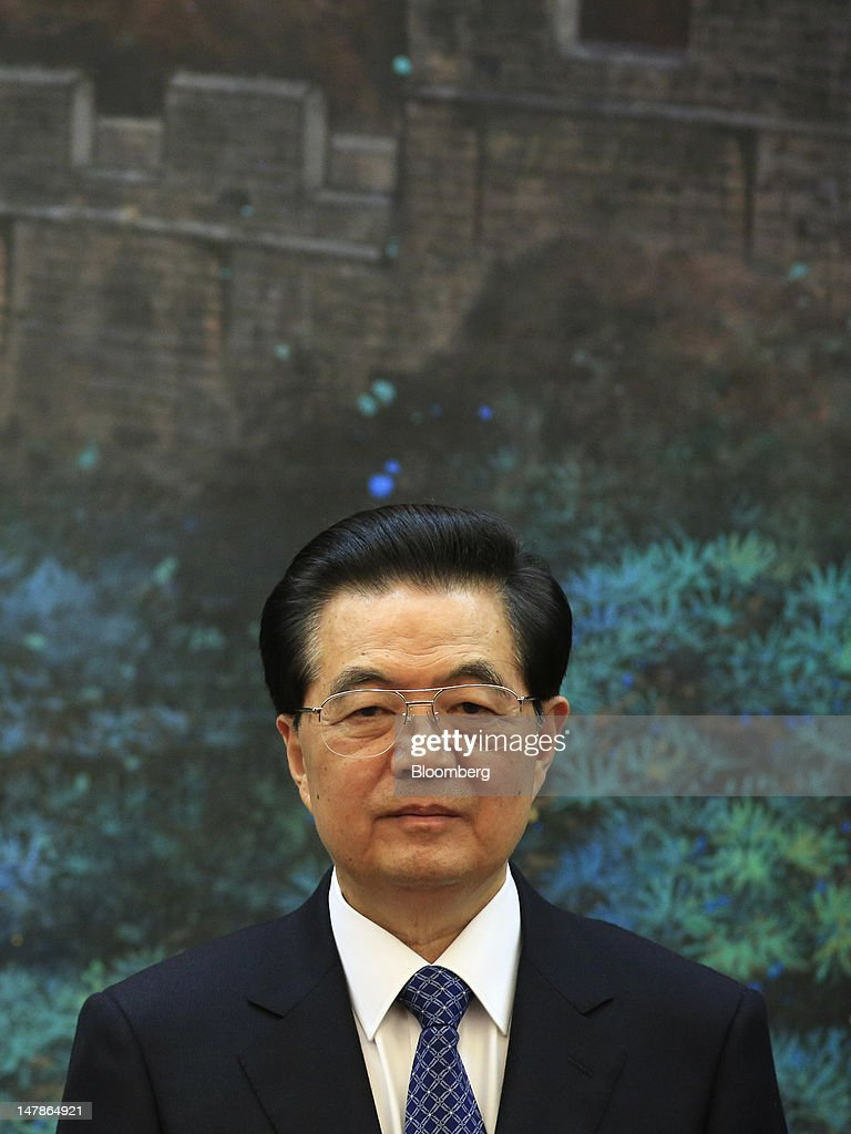<a gi-track='captionPersonalityLinkClicked' href=/galleries/search?phrase=Hu+Jintao&family=editorial&specificpeople=203109 ng-click='$event.stopPropagation()'>Hu Jintao</a>, president of China, stands at attention during a signing ceremony in Beijing, China, on Thursday, July 5, 2012. Castro is visiting China from July 4-6. Photographer: Nelson Ching/Bloomberg via Getty Images