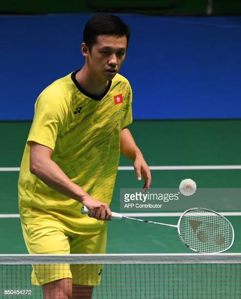 Hu Yun of Hong Kong hits a return against Srikanth Kidambi of India during their men's singles second round match at the Japan Open Badminton...