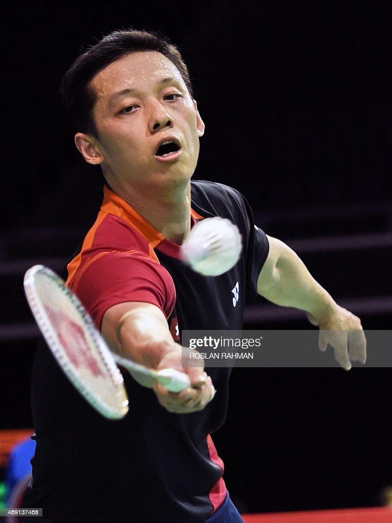 Hu Yun of Hong Kong returns a shot against Tian Houwei of China in