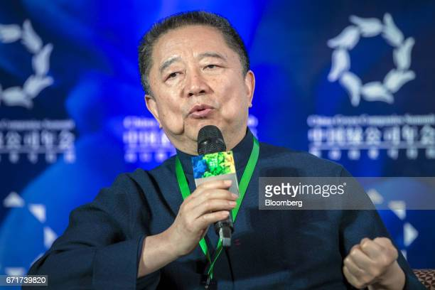 Hua Jianming chairman and founder of Central China Real Estate Ltd speaks during a session at the China Green Companies Summit in Zhengzhou China on...