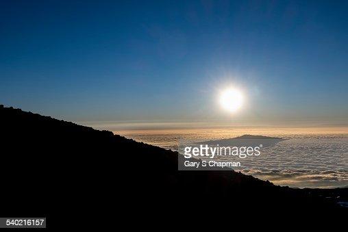 Hualalai peaks through the clouds