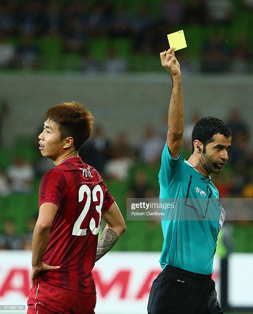 Huan Fu of Shanghai SIPG is shown the yellow card by referee referee Abdulrahman Al-Jassim during the AFC Asian Champions League match between Melbourne Victory and Shanghai Sipg at AAMI Park on February 24, 2016 in Melbourne, Australia.