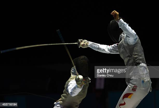 Huang Ali of China competes with Sabrina Massialas of the United States in the Women's Foil Individual Preliminary Round Competition at the Fencing...