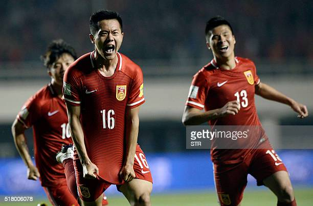 Huang Bowen of China celebrates with his teammates after scoring a goal during the 2018 World Cup football qualifying match against Qatar in Xi'an...