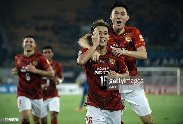 Huang Bowen of China's Guangzhou Evergrande celebrates with teammates after scoring a goal against Japans Gamba Osaka during their AFC Champions...