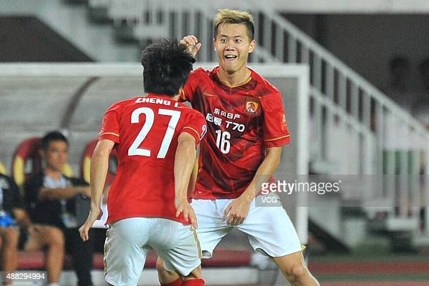 Huang Bowen of Guangzhou Evergrande celebrates with team mate after scoring his team's first goal during the AFC Champions League quarterfinal...