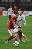 Huang Bowen of Guangzhou Evergrande competes the ball with Tomi Juric of Western Sydney Wanderers during the AFC Asian Champions League match between...