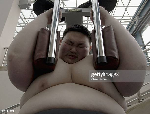 Huang Jiaxin fifteenyearsold performs weight reducing exercise at the Aimin Slimming Centre on March 20 2006 in Wuhan of Hubei Province China Doctors...