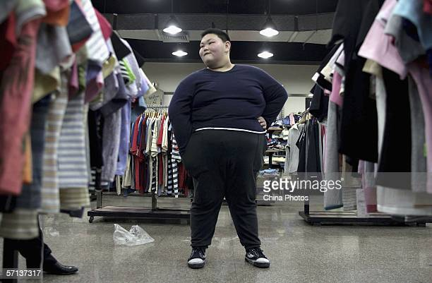 Huang Jiaxin fifteenyearsold shops for clothes after performing weight reducing exercise at the Aimin Slimming Centre on March 20 2006 in Wuhan of...