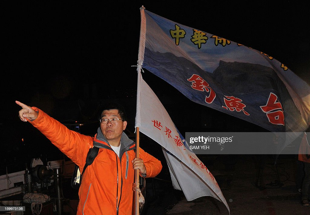Huang Xilin, a Taiwan right-wing activist, points on a damaged fishing boat at the Sheng Ao fish harbour in northern city of Keelung on January 24, 2013. A boat with Taiwanese activists headed for disputed Japanese-controlled islands turned back after coastguard vessels from the two sides converged and duelled with water cannon. AFP PHOTO / Sam Yeh