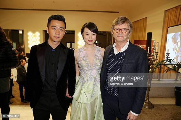 Huang Xuan Huang Lu and Bille August attend the SIFF's Cocktail Reception at PalmenhofSilbersaal on February 8 2014 in Berlin Germany