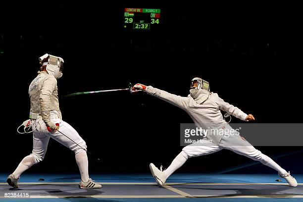 Huang Yaojiang of China and Balazs Karoly Lontay of Hungary compete in the men's team sabre fencing semifinals at the Fencing Hall of National...