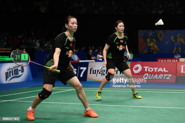 Huang Yaqiong and Yu Xiaohan of China compete against Misaki Matsutomo and Ayaka Takahashi of Japan during Womens Double Round 2 match of the BCA...