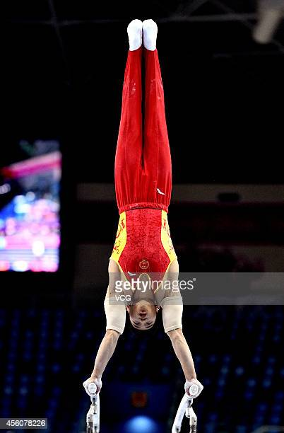 Huang Yuguo competes in men's parallel bars final during day six of the 2014 Asian Games at Namdong Gymnasium on September 25 2014 in Incheon South...