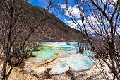 Huanglong is a nature reserve famous for its colorful natural pools and waterfalls. Huanglong is located in the Tibetan-Qiang Autonomous Prefecture of Sichuan.