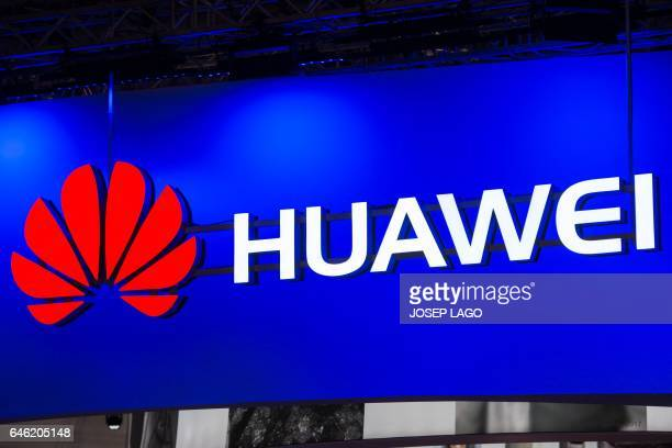 A Huawei logo hangs from a beam during the Mobile World Congress on the second day of the MWC in Barcelona on February 28 2017 Phone makers will seek...