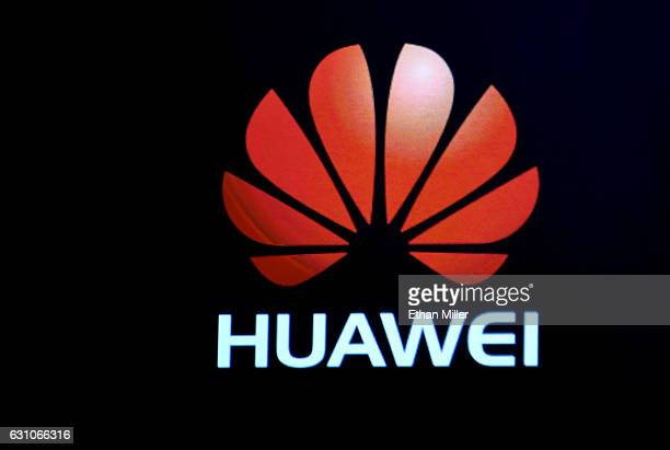Huawei logo is shown on a screen during a keynote address by CEO of Huawei Consumer Business Group Richard Yu at CES 2017 at The Venetian Las Vegas...