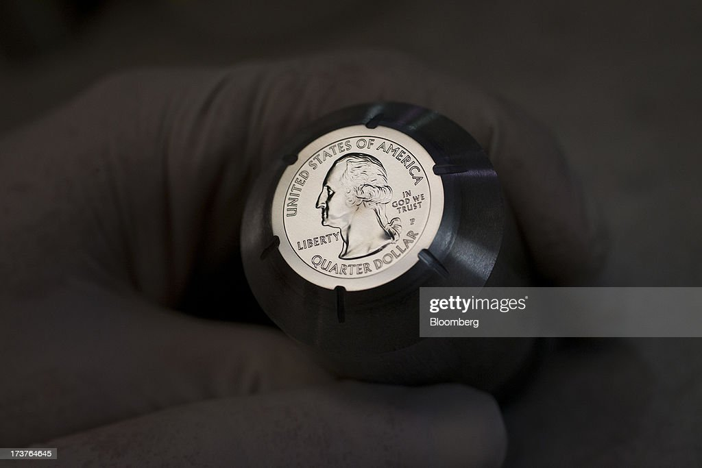 A hub, used to create a die for a U.S. quarter dollar, is displayed for a photograph at the U.S. Mint in Philadelphia, Pennsylvania, U.S., on Wednesday, July 17, 2013. Some sources of declining inflation 'are likely to be transitory' and expectations for future price increases 'have generally remained stable,' Ben S. Bernanke, chairman of the U.S. Federal Reserve said in prepared remarks. Photographer: Scott Eells/Bloomberg via Getty Images