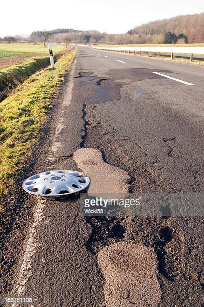 Hubcap on a Damaged Road