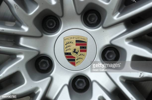 A hubcap ornament shows the Porsche logo on a Porsche Cayenne diesel SUV parked on June 13 2017 in Berlin Germany Spiegel magazine after conducting...