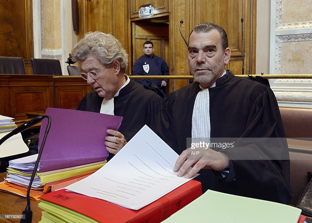 Hubert Delarue (L) and Frank Berton (R), lawyers of Stephane Moitoiret and Noëlla Hego accused of the murder in 2008 of ten-year old Valentin, wait in the Lyon courthouse before the appeal trial on November 12, 2013. Moitoret and Hego were respectively sentenced in 2011 to life imprisonment and 18 years in prison.