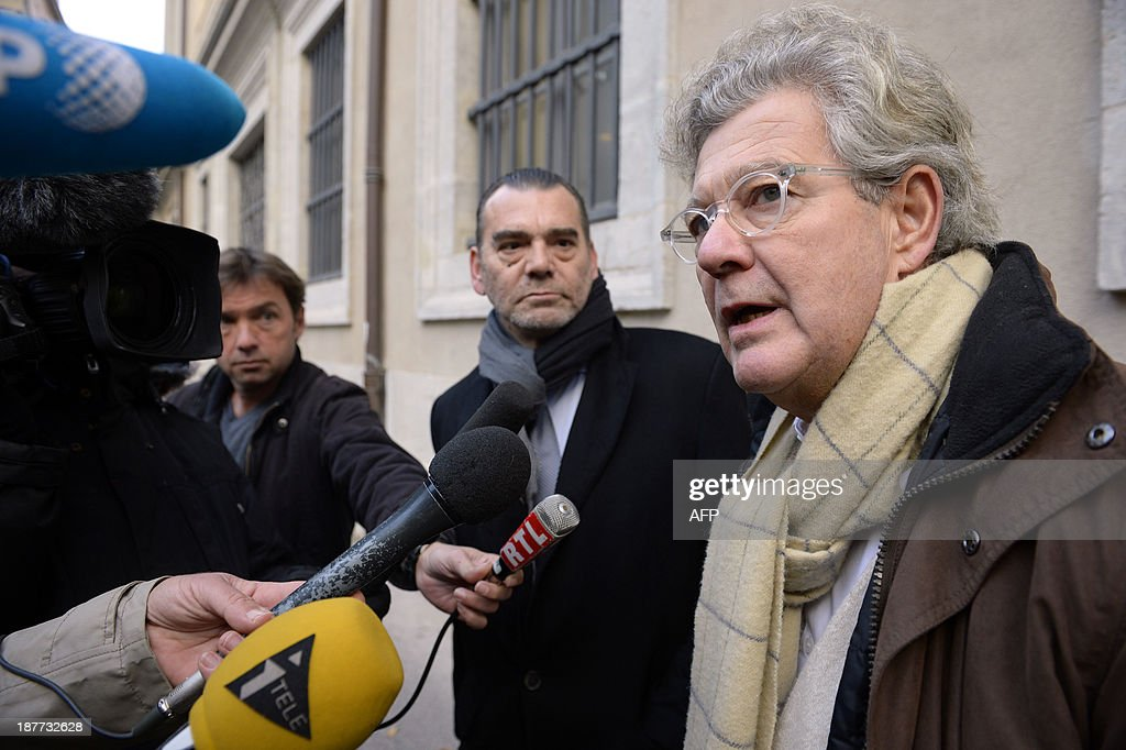 Hubert Delarue (R) and Frank Berton (L), lawyers of Stephane Moitoiret and Noëlla Hego accused of the murder in 2008 of ten-year old Valentin, speak to the press at the Lyon courthouse before the appeal trial on November 12, 2013. Moitoret and Hego were respectively sentenced in 2011 to life imprisonment and 18 years in prison.