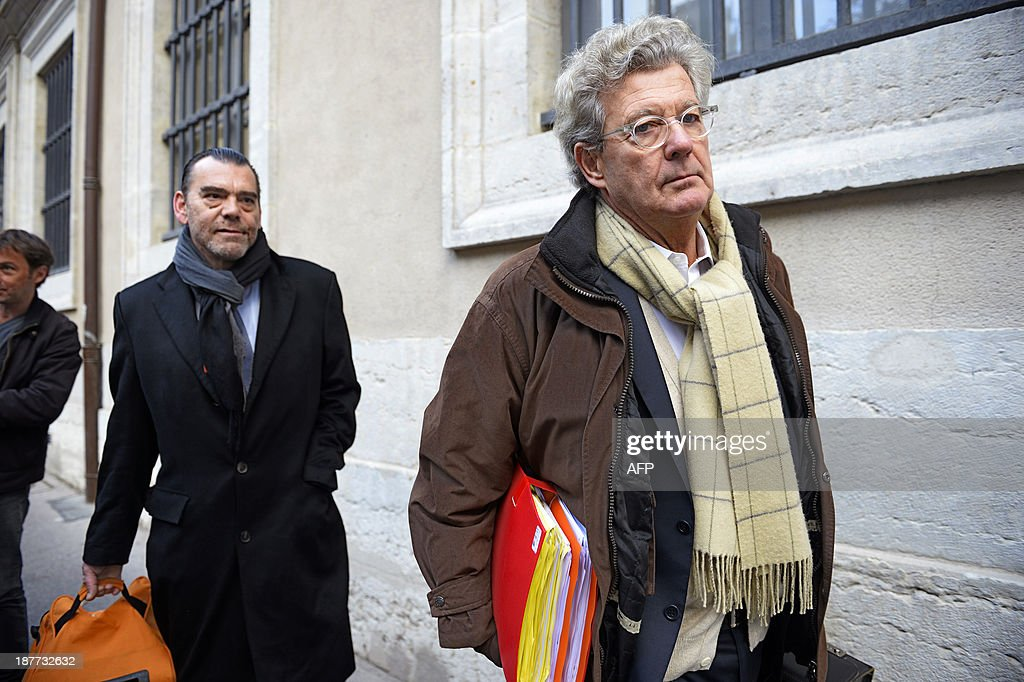 Hubert Delarue (R) and Frank Berton (L), lawyers of Stephane Moitoiret and Noëlla Hego accused of the murder in 2008 of ten-year old Valentin, arrive at the Lyon courthouse before the appeal trial on November 12, 2013. Moitoret and Hego were respectively sentenced in 2011 to life imprisonment and 18 years in prison.