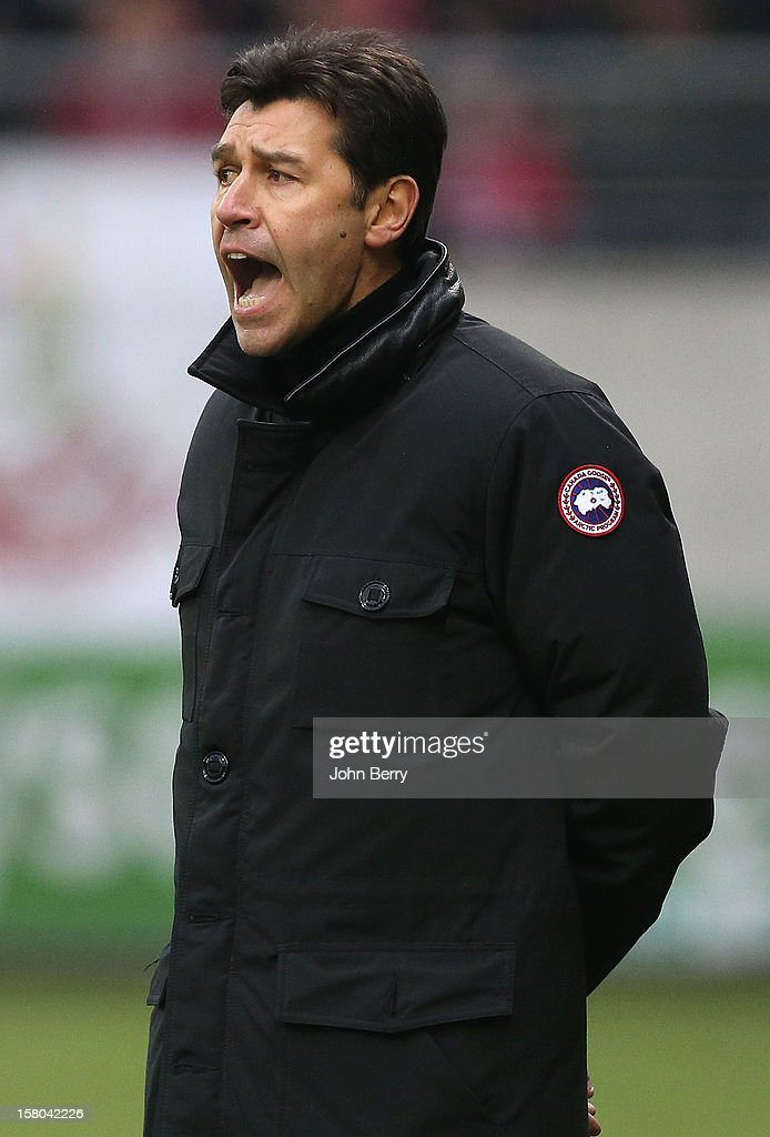 Hubert Fournier, coach of Reims looks on during the French Ligue 1 match between Stade de Reims and Girondins de Bordeaux at the Stade Auguste Delaune on December 9, 2012 in Reims, France.