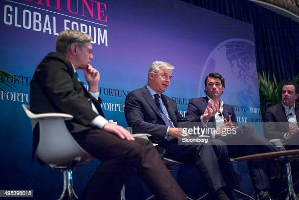 Hubert Joly chairman and chief executive officer of Best Buy Co Inc second left speaks as Gavin Patterson chief executive officer of BT Group PLC...