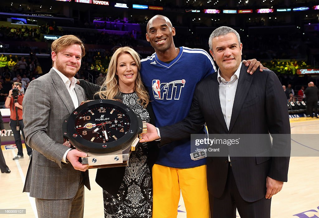 Hublot Beverly Hills Boutique President, Greg Simonian, Los Angeles Lakers Executive Vice President of Business Operations, Jeanie Buss, Los Angeles Laker <a gi-track='captionPersonalityLinkClicked' href=/galleries/search?phrase=Kobe+Bryant&family=editorial&specificpeople=201466 ng-click='$event.stopPropagation()'>Kobe Bryant</a> and CEO of Hublot, Ricardo Guadalupe are seen at center court during a presentation naming Hublot the official timekeeper of the Los Angeles Lakers at Staples Center on January 29, 2013 in Los Angeles, California.