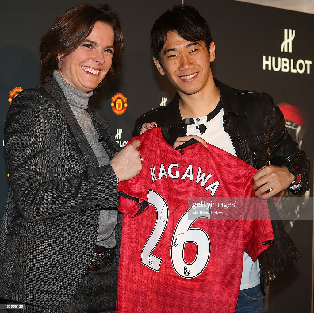 Hublot marketing director Valerie Servageon Grande and Shinji Kagawa of Manchester United take part in a press conference before taking part in a charity shooting challenge at Old Trafford on March 12, 2013 in Manchester, England.