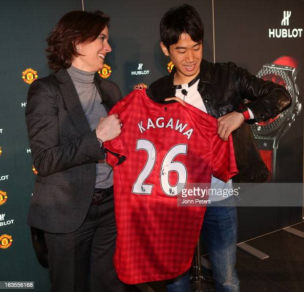 Hublot marketing director Valerie Servageon Grande and Shinji Kagawa of Manchester United take part in a press conference before taking part in a...