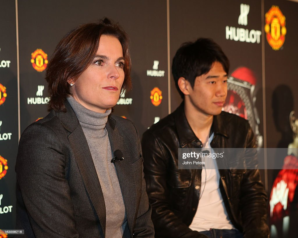 Hublot marketing director Valerie Servageon Grande and <a gi-track='captionPersonalityLinkClicked' href=/galleries/search?phrase=Shinji+Kagawa&family=editorial&specificpeople=4314029 ng-click='$event.stopPropagation()'>Shinji Kagawa</a> of Manchester United take part in a press conference before taking part in a charity shooting challenge at Old Trafford on March 12, 2013 in Manchester, England.