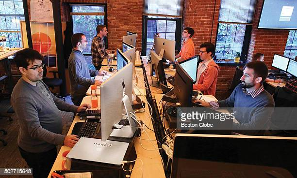 HubSpot employees work at their standing desks on Monday October 27 2014 Front to back on left are Rodolfo Carvalho Matt Veitas and Andy Corcoran...
