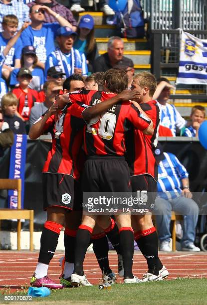 Huddersfield celebrate Benik Afobe's goal during the League One match at the Withdean Stadium Brighton