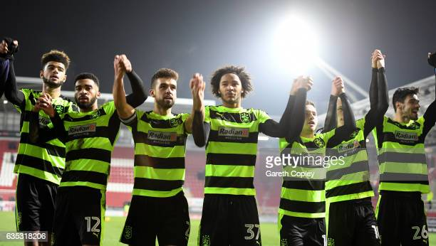 Huddersfield celebrate winning the Sky Bet Championship match between Rotherham United and Huddersfield Town at The New York Stadium on February 14...