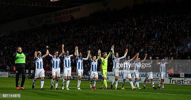 Huddersfield celebrate with fans after winning The Emirates FA Cup Third Round match between Huddersfield Town and Port Vale at Galpharm Stadium on...