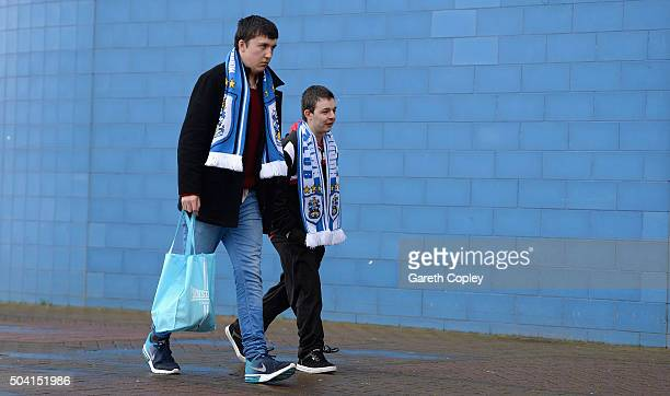 Huddersfield fans arrive for The Emirates FA Cup Third Round between Huddersfield Town and Reading at John Smiths Stadium on January 9 2016 in...