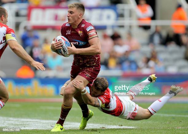 Huddersfield Giants' Alex Mellor is tackled by Catalans Dragons Richie Myler during day two of the Betfred Super League Magic Weekend at St James'...
