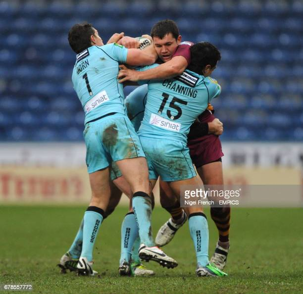 Huddersfield Giants' Brett Ferres is tackled by London Broncos' Luke Dorn and Michael Channing